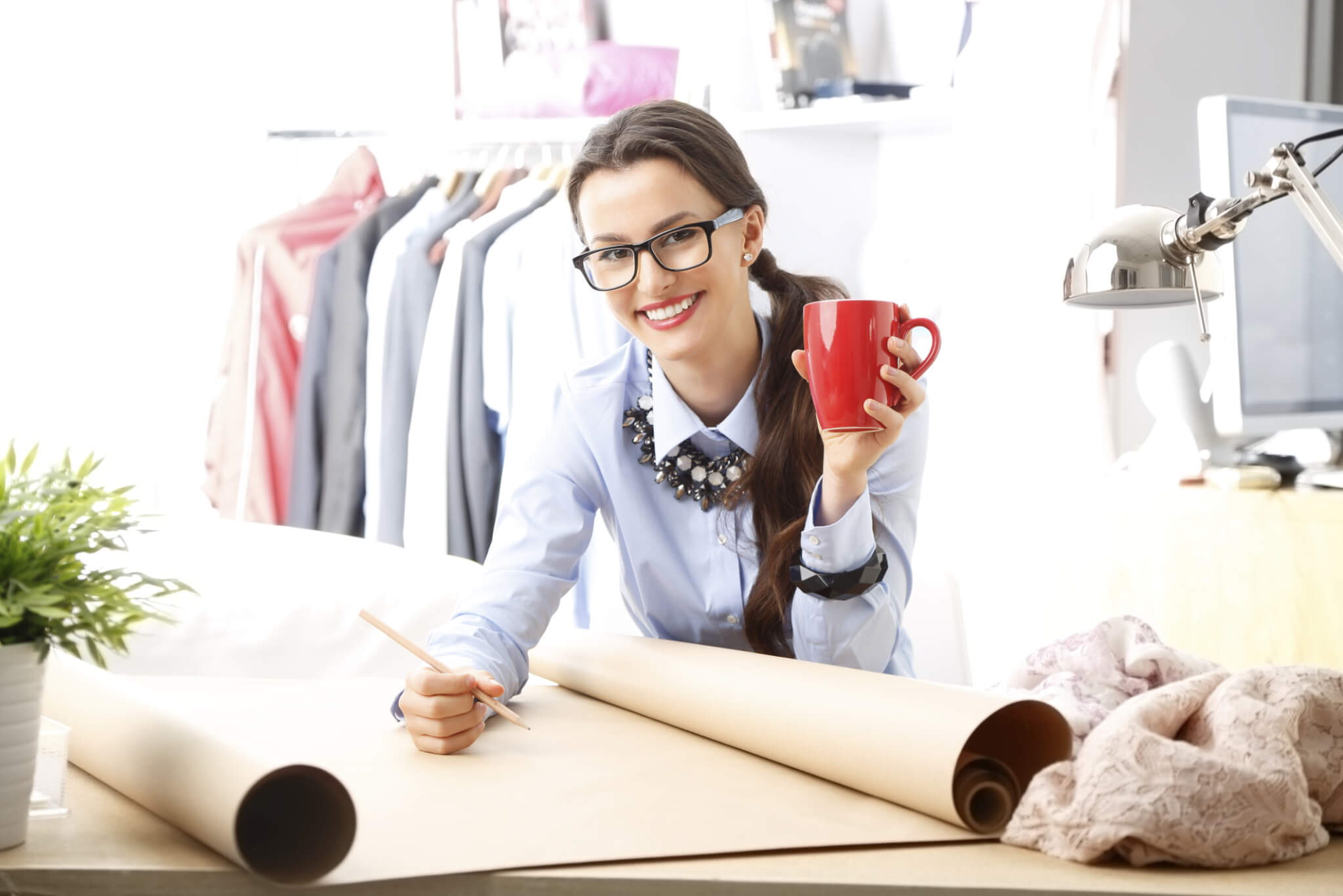 woman in glasses with red mug