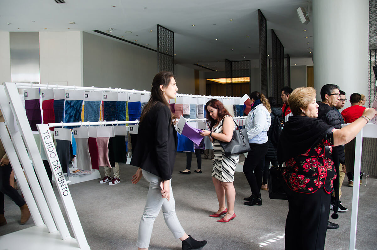 people looking at fabric samples